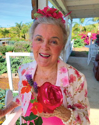 Patricia Bragg with Flowers